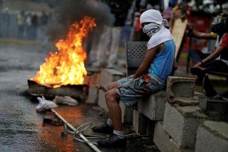 A demonstrator looks on while rallying against Venezuela's President Nicolas Maduro's government in Caracas