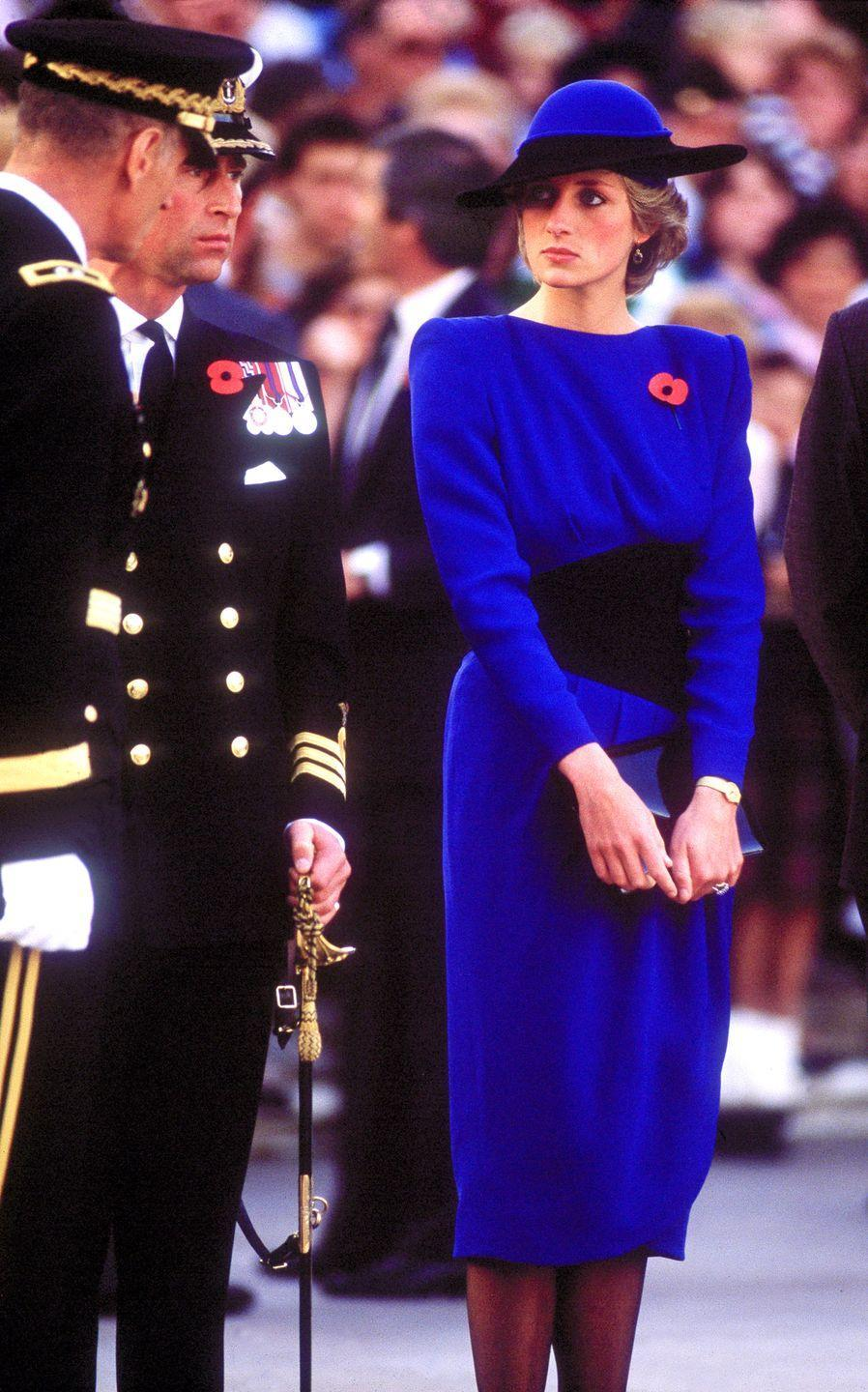 <p>In a blue dress and hat designed by Bruce Oldfield at Arlington Cemetery in Washington, D.C. </p>