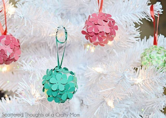 """<p>You don't need any fancy crafting equipment to make these textured balls—just a shaped hole punch and some straight pins. </p><p><em>Get the tutorial at <a href=""""https://www.scatteredthoughtsofacraftymom.com/kid-craft-paper-christmas-tree-ornaments/"""" rel=""""nofollow noopener"""" target=""""_blank"""" data-ylk=""""slk:Scattered Thoughts of a Crafty Mom"""" class=""""link rapid-noclick-resp"""">Scattered Thoughts of a Crafty Mom</a>.</em></p><p><a class=""""link rapid-noclick-resp"""" href=""""https://www.amazon.com/LoveInUSA-Scrapbooking-Supplies-Crafting-Projects/dp/B075NC2PT7?tag=syn-yahoo-20&ascsubtag=%5Bartid%7C10072.g.34443405%5Bsrc%7Cyahoo-us"""" rel=""""nofollow noopener"""" target=""""_blank"""" data-ylk=""""slk:SHOP PUNCH SET"""">SHOP PUNCH SET</a></p>"""