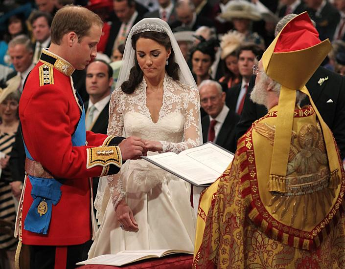 Britain's Prince William, and Kate Middleton exchange rings before the Archbishop of Canterbury, Rowan Williams, during their wedding ceremony In Westminster Abbey, in central London April 29, 2011.   (ROYAL WEDDING/SERVICE)      REUTERS/Dominic Lipinski/Pool     (BRITAIN - Tags: ENTERTAINMENT SOCIETY ROYALS)