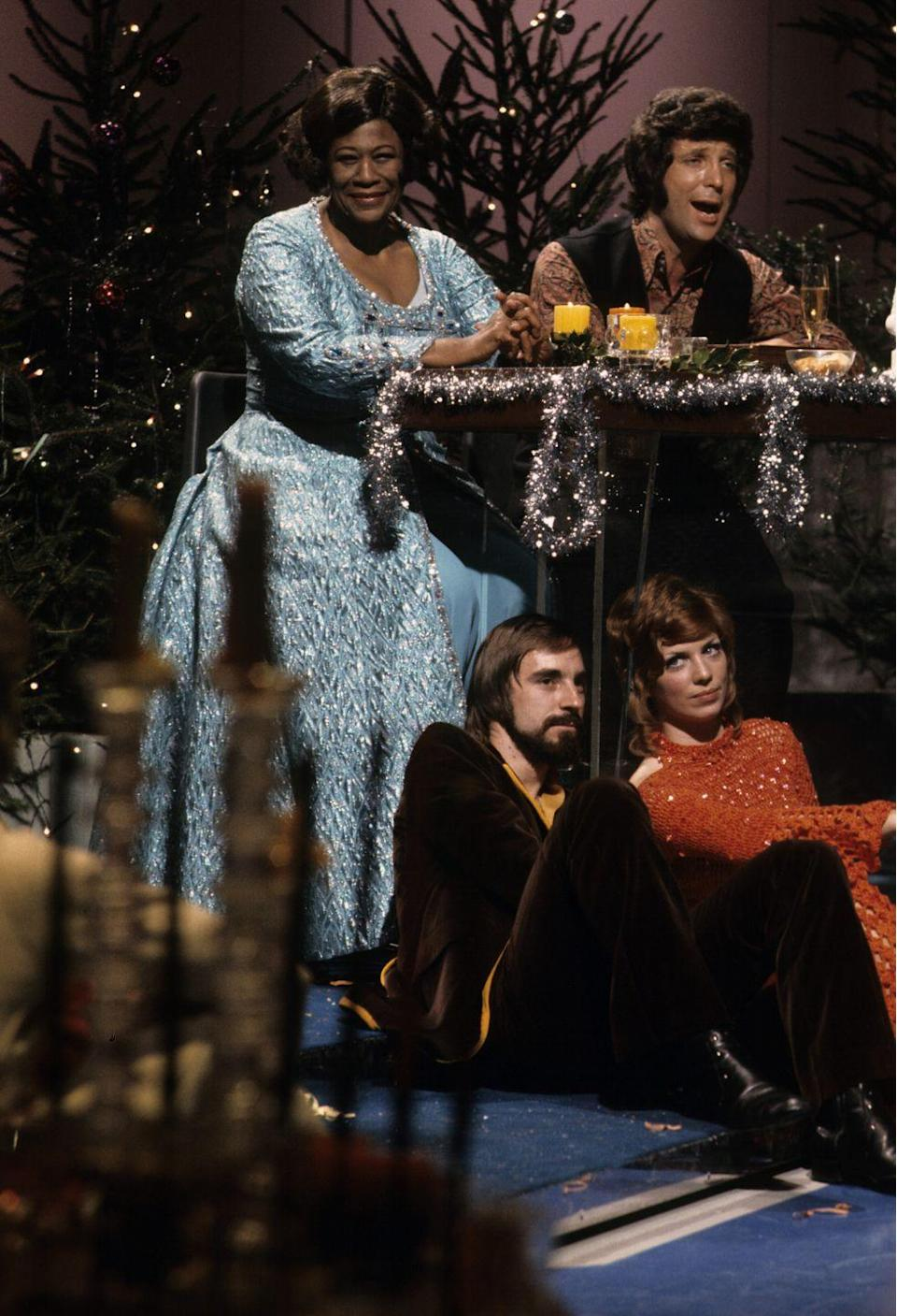<p>Ella Fitzgerald joins '70s star, Tom Jones, on the set of his show <em>This Is Tom Jones</em> for a special holiday episode. The jazz singer wore a blue sparkly dress amidst a set full of Christmas decorations. </p>