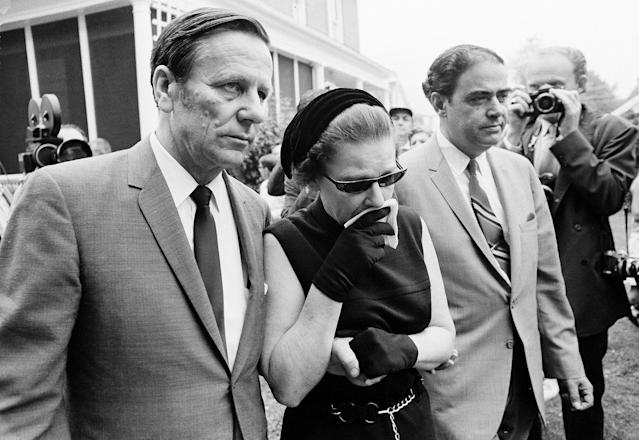 <p>Joseph Kopechne of Berkley, N.J., supports his weeping wife Gwen as the grieving parents of drowning victim Mary Jo Kopechne, 29, walk into St. Vincent's Chruch in Plymouth, Pa., for funeral services for their daughter, July 2, 1969. (Photo: AP) </p>