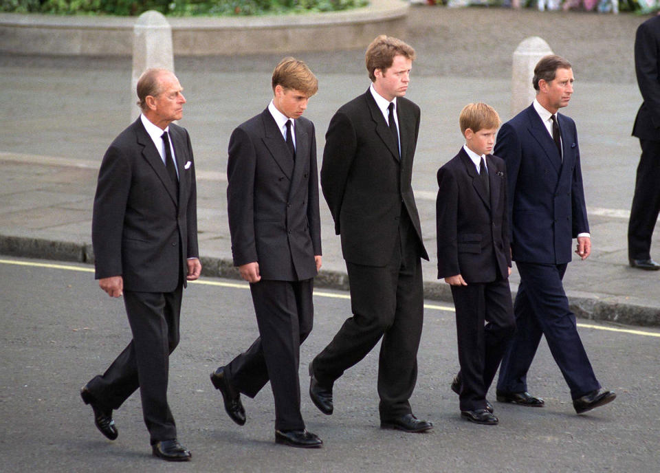 Prince Harry walks behind his mother's coffin with Prince Charles, Prince William, and Earl Spencer (Picture: BBC)
