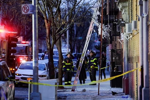 <p>Fire Department of New York (FDNY) personnel work on the scene of an apartment fire in Bronx, New York, Dec. 29, 2017. (Photo: Eduardo Munoz/Reuters) </p>
