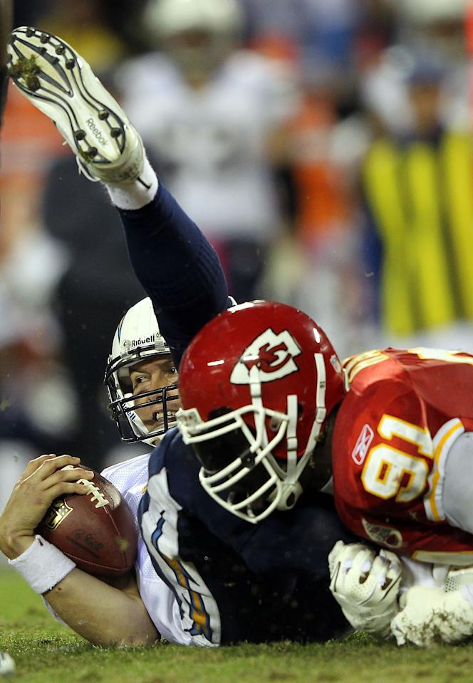 KANSAS CITY, MO - OCTOBER 31:  Quarterback Philip Rivers #17 of the San Diego Chargers is sacked by Tamba Hali #91 of the Kansas City Chiefs during the game on October 31, 2011 at Arrowhead Stadium in Kansas City, Missouri.  (Photo by Jamie Squire/Getty Images)