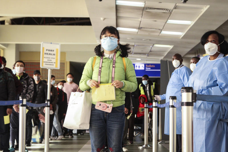 Passengers arriving from a China Southern Airlines flight from Changsha in China are screened for the new type of coronavirus, whose symptoms are similar to the cold or flu and many other illnesses, upon their arrival at the Jomo Kenyatta international airport in Nairobi, Kenya, Wednesday, Jan. 29, 2020. Some countries began evacuating their citizens Wednesday from Wuhan, the Chinese city hardest-hit by an outbreak of the new virus that is thought to have killed over one hundred people and infected more than 6,000. (AP Photo/Patrick Ngugi)