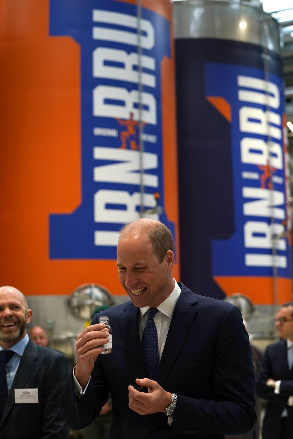 <p>William and the queen enjoy a taste of the Irn-Bru drink at the factory.</p>