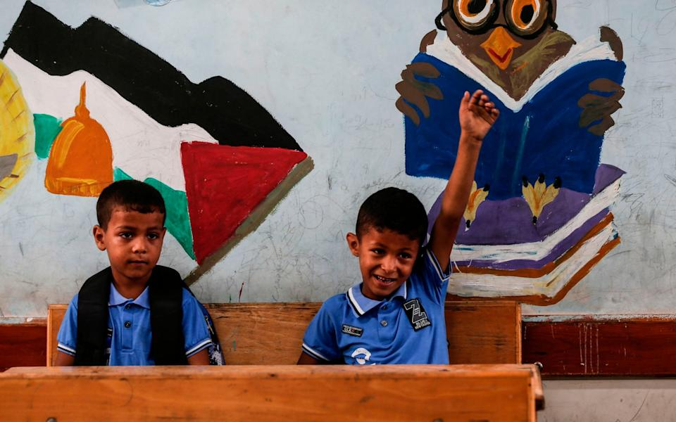 Palestinian students attend a class at school today - AHMUD HAMS/AFP