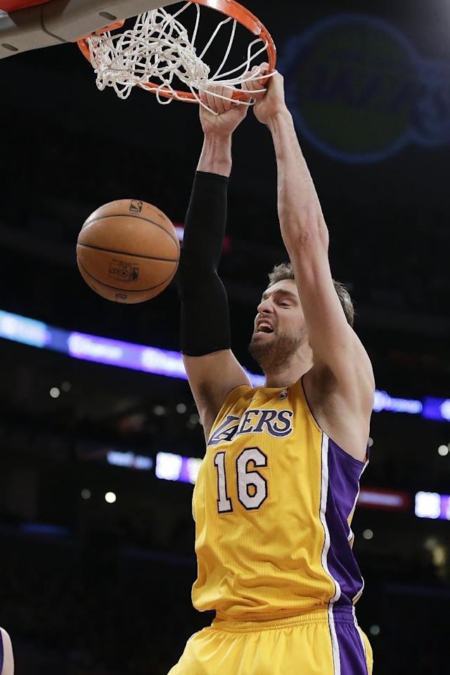 Los Angeles Lakers center Pau Gasol dunks against the Phoenix Suns during the first half of an NBA basketball game in Los Angeles, Tuesday, Dec. 10, 2013. (AP Photo/Chris Carlson)