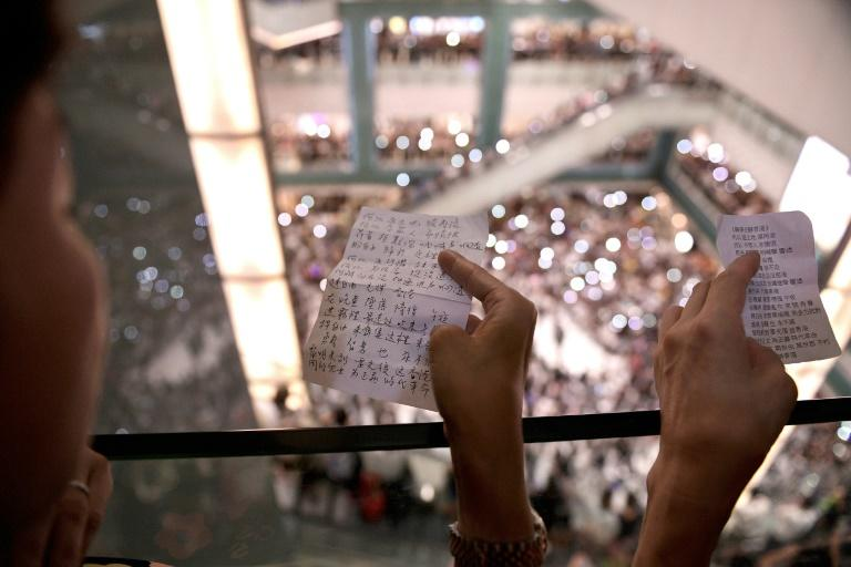 Protesters have gathered at Hong Kong malls to sing a new anthem penned by an anonymous composer
