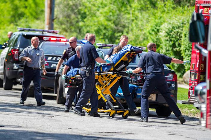 Rescue workers take 12-year-old stabbing victim Payton Leutner to an ambulance in Waukesha, Wis., in 2014.