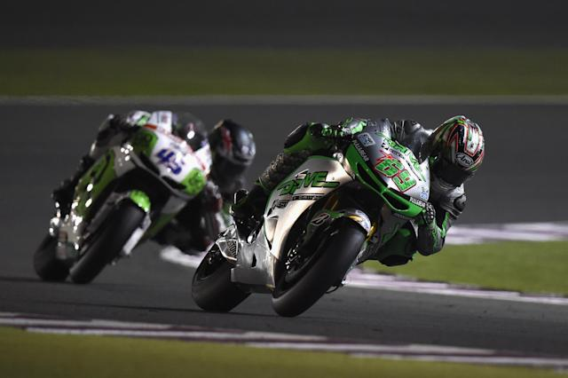 DOHA, QATAR - MARCH 23: Nicky Hayden of USA and Drive M7 Aspar leads the field during the MotoGP race during the MotoGp of Qatar - Race at Losail Circuit on March 23, 2014 in Doha, Qatar. (Photo by Mirco Lazzari gp/Getty Images)