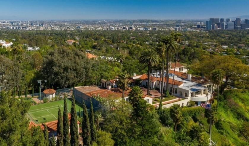 The 2.5-acre spread includes a 1930s home, two guesthouses, a screening room, swimming pool and tennis court.