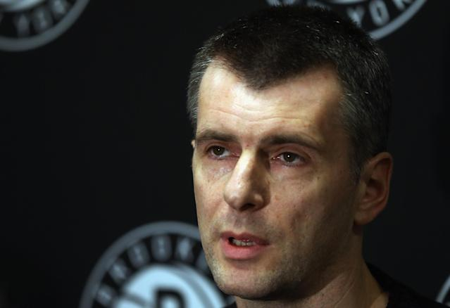 NEW YORK, NY - DECEMBER 28: Brooklyn Nets owner Mikhail Prokhorov addresses the media regarding the firing of Avery Johnson at halftime of the game between the Nets and the Charlotte Bobcats at the Barclays Center on December 28, 2012 in the Brooklyn borough of New York City. NOTE TO USER: User expressly acknowledges and agrees that, by downloading and/or using this photograph, user is consenting to the terms and conditions of the Getty Images License Agreement. (Photo by Bruce Bennett/Getty Images)