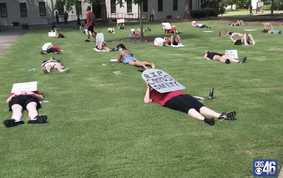 "Students and faculty members at the University of Georgia staged an August 6 ""die-in"" protest in response to the school's fall plans. (Screenshot: CBS46)"