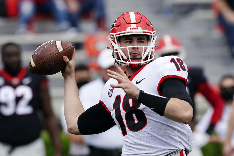 FILE - In this April 17, 2021, file photo, Georgia quarterback JT Daniels (18) throws a pass during their spring NCAA college football spring game in Athens, Ga. Daniels starred for a powerhouse team in high school. He launched his college career at one of the most storied programs in the nation. Yet none of that quite prepared this laid-back Californian for the passion that goes along with playing for the Georgia Bulldogs, for playing in the Southeastern Conference. (AP Photo/John Bazemore, File)