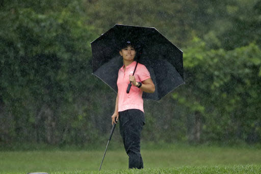 Dannielle Kang stands under an umbrella while waiting to putt on the eighth hole during the second round of the LPGA Drive On Championship golf tournament Saturday, Aug. 1, 2020 at Inverness Golf Club in Toledo, Ohio. (AP Photo/Gene J. Puskar)