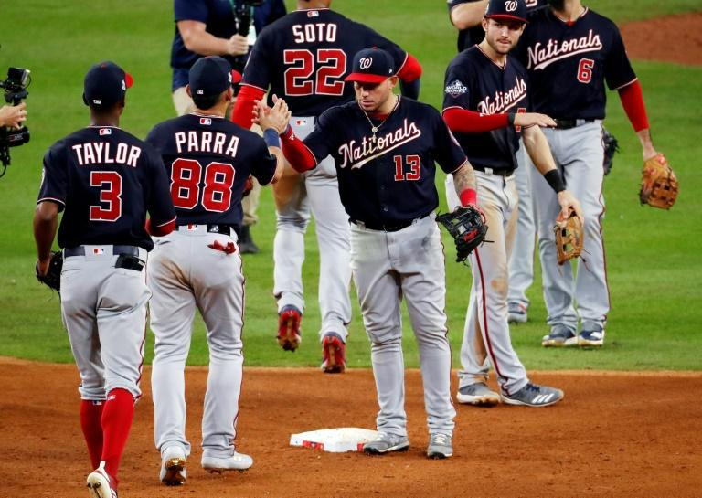 Washington's Asdrubal Cabrera celebrates with his Nationals teammates after their 12-3 win over the Houston Astros in game two of the 2019 World Series (AFP Photo/Tim Warner)