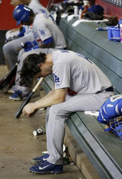 Los Angeles Dodgers' Dan Haren sits dejectedly in the dugout after giving up a 2-run home run to Arizona Diamondbacks' Eric Chavez after Haren pitched in the fifth inning of a baseball game on Sunday, May 18, 2014, in Phoenix. (AP Photo/Ross D. Franklin)
