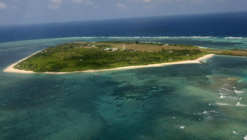 An aerial photo shows Thitu Island, part of the disputed Spratly group of islands, in the South China Sea on July 20, 2011 (AFP Photo/Rolex Dela Pena)