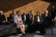 """King Willem-Alexander, second right, talks to survivors and relatives after officially unveiling a new monument in the heart of Amsterdam's historic Jewish Quarter on Sunday, Sept. 19, 2021, honoring the 102,000 Dutch victims of the Holocaust. Designed by Polish-Jewish architect Daniel Libeskind, the memorial is made up of walls shaped to form four Hebrew letters spelling out a word that translates as """"In Memory Of."""" The walls are built using bricks each of which is inscribed with the name of one of the 102,000 Jews, Roma and Sinti who were murdered in Nazi concentration camps during World War II or who died on their way to the camps. (AP Photo/Peter Dejong)"""