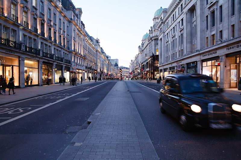 A lone taxi drives down an almost deserted Regent Street in London, England, on March 16, 2020. Around the country, as elsewhere in the world, covid-19 coronavirus fears continue to escalate as the numbers of cases and deaths continues to rise. British Prime Minister Boris Johnson this afternoon announced a ramping-up of measures designed to slow the spread of the virus in the UK, including asking for everyone to work from home where possible and for people to avoid 'non-essential' contact with others. (Photo by David Cliff/NurPhoto via Getty Images)