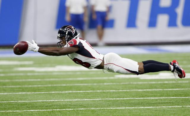 <p>Atlanta Falcons wide receiver Taylor Gabriel stretches but is unable to catch the pas during the first half of an NFL football game against the Detroit Lions, Sunday, Sept. 24, 2017, in Detroit. (AP Photo/Duane Burleson) </p>