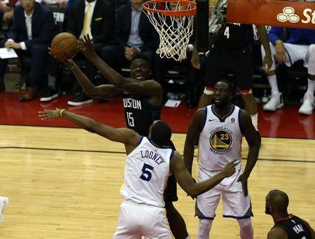 May 24, 2018; Houston, TX, USA; Houston Rockets center Clint Capela (15) attempts a shot around Golden State Warriors forward Kevon Looney (5) during the third quarter in game five of the Western conference finals of the 2018 NBA Playoffs at Toyota Center. Mandatory Credit: John Glaser-USA TODAY Sports