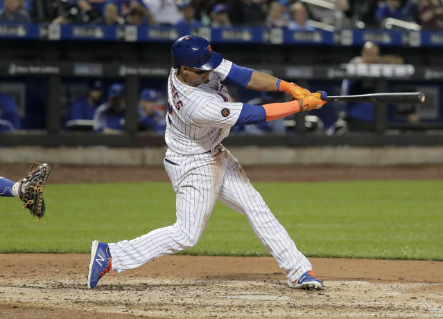 New York Mets' Juan Lagares swings for a two-run single against the Toronto Blue Jays during the fourth inning of a baseball game Tuesday, May 15, 2018, in New York. (AP Photo/Julie Jacobson)
