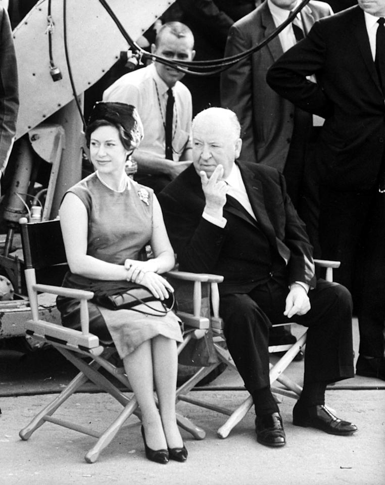 Princess Margaret with Alfred Hitchcock on a set visit of his film <em>Torn Curtain</em> at Universal City Studios in California, during their royal tour of America in November 1965.