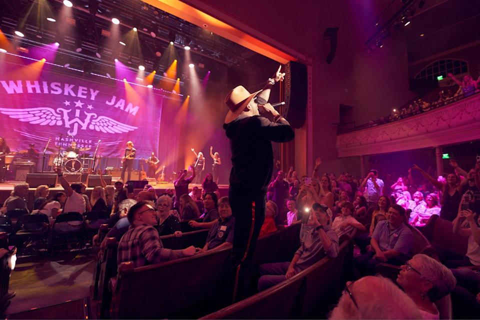 """<p>Jimmie Allen has been bringing high energy to the crowds of Whiskey Jam since 2012, this night hopping off the stage and into the pews to get the crowd singing along to """"Make Me Want To.""""</p>"""
