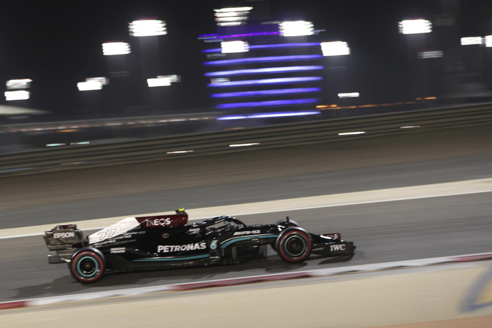 Mercedes driver Valtteri Bottas of Finland steers his car during the qualifying session for Sunday's Bahrain Formula One Grand Prix, at the Bahrain International Circuit in Sakhir, Bahrain, Saturday, March 27, 2021. The Bahrain Formula One Grand Prix will take place on Sunday. (AP Photo/Kamran Jebreili)