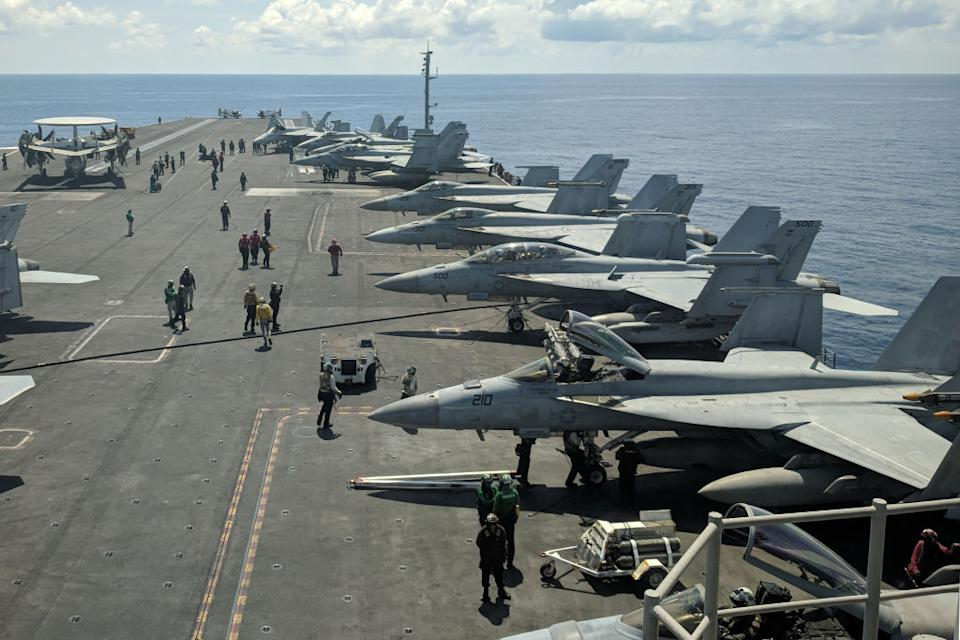 US Navy F/A-18 Super Hornets multirole fighters and an EA-18G Growler electronic warfare aircraft (2nd R) on board USS Ronald Reagan aircraft carrier as it sails in South China Sea. Source: Getty