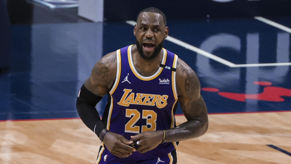 Los Angeles Lakers forward LeBron James (23) and his team are still favored to win the West. (AP Photo/Derick Hingle)