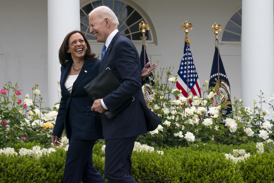 Vice President Kamala Harris and President Joe Biden smile and walk off after speaking about updated guidance on mask mandates, in the Rose Garden of the White House, Thursday, May 13, 2021, in Washington. (AP Photo/Evan Vucci)