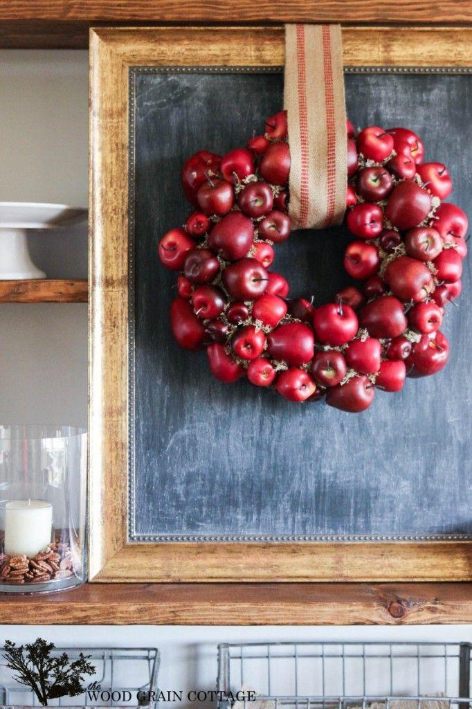 """<p>Fake apples lend themselves to create a striking, royally red wreath. </p><p><strong>Get the tutorial at <a href=""""http://www.thewoodgraincottage.com/2014/09/17/diy-apple-wreath/"""" rel=""""nofollow noopener"""" target=""""_blank"""" data-ylk=""""slk:The Wood Grain Cottage"""" class=""""link rapid-noclick-resp"""">The Wood Grain Cottage</a>.</strong> </p>"""