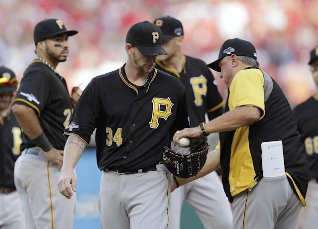 Pittsburgh Pirates pitcher A.J. Burnett is taken out by manager Clint Hurdle, right, in the third inning of Game 1 of baseball's National League division series against the St. Louis Cardinals on Thursday, Oct. 3, 2013, in St. Louis. (AP Photo/Charlie Riedel)