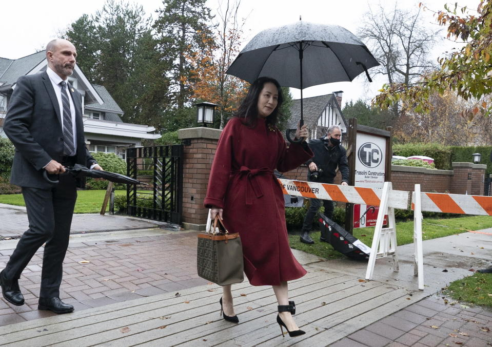 Meng Wanzhou, chief financial officer of Huawei, leaves her home in Vancouver, British Columbia Wednesday, Nov. 18, 2020, to attend an evidentiary hearing in her extradition case at B.C. Supreme Court. (Jonathan Hayward/The Canadian Press via AP)