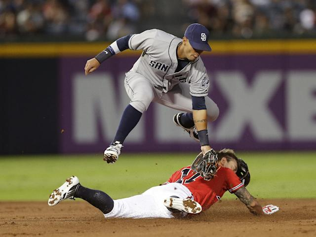 Atlanta Braves Jordan Schafer steals second base as San Diego Padres shortstop Ronny Cedeno handles the late throw in the first inning of a baseball game Friday, Sept. 13, 2013, in Atlanta. (AP Photo/John Bazemore)