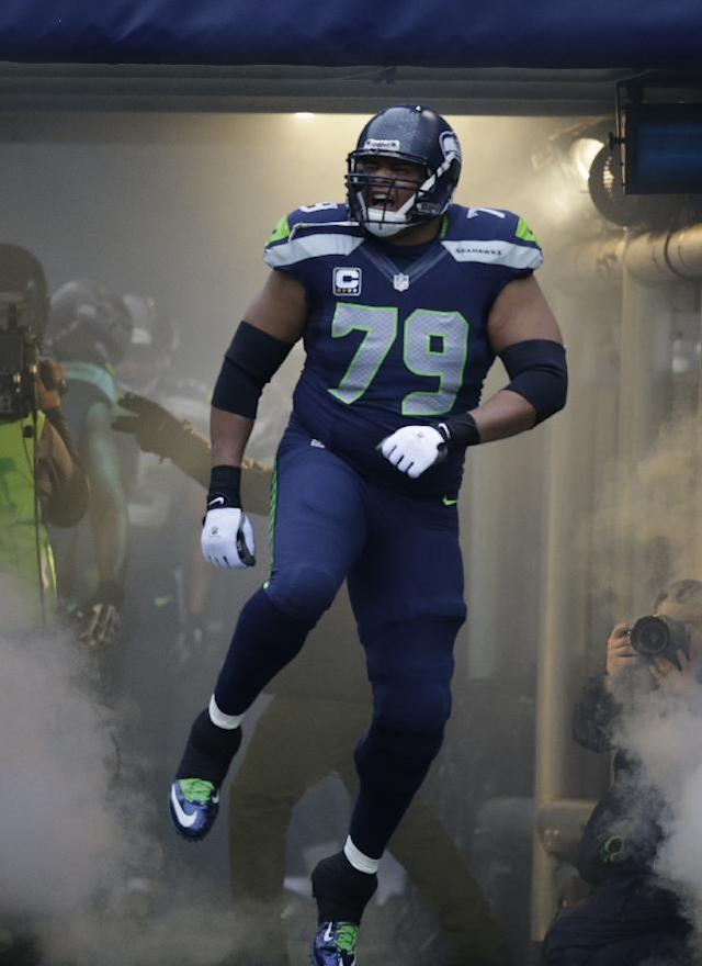 Seattle Seahawks' Red Bryant is introduced before an NFL football game against the St. Louis Rams, Sunday, Dec. 29, 2013, in Seattle. (AP Photo/Elaine Thompson)