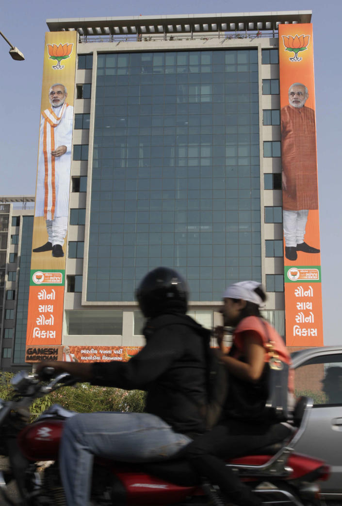 In this Saturday, Dec. 1, 2012 photo, huge posters of Gujarat Chief Minister Narendra Modi are displayed on the facade of a multi story building where the election campaign office of a Bharatiya Janata Party candidate functions in Ahmadabad, India. Eleven years after Modi became the chief minister of the western state of Gujarat - and 10 years after brutal anti-Muslim rioting left over a 1,100 people there dead - Modi is campaigning for his third term. Nearly everyone expects him to be swept into office, and the top leadership of his rightwing Bharatiya Janata Party is already hailing him as a future prime minister. But few politicians in India are as polarizing as Modi. (AP Photo/Ajit Solanki)