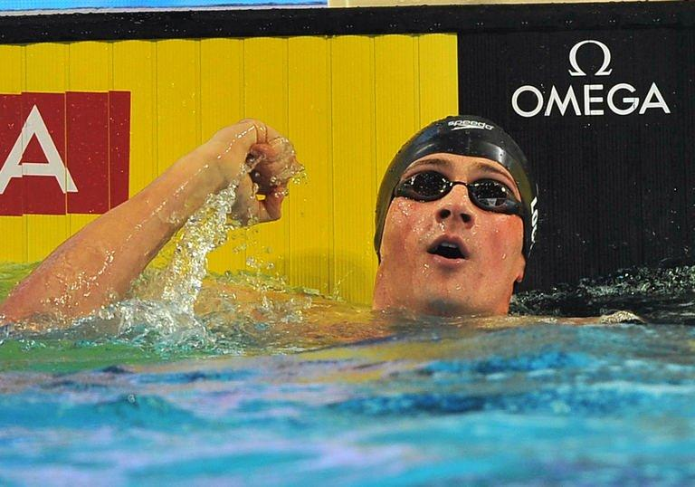 USA's Ryan Lochte competes in the men's 100m individual medley semi-finals