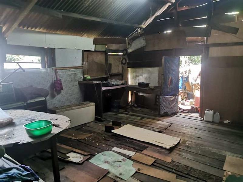 The kitchen was turned into a makeshift place to wash the body before it can be buried. — Picture from Facebook/Yunizam Yusop