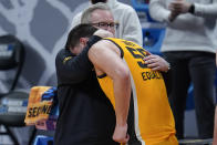 Iowa head coach Fran McCaffery hugs Luka Garza (55) during the second half of a men's college basketball game against Oregon in the second round of the NCAA tournament at Bankers Life Fieldhouse in Indianapolis, Monday, March 22, 2021. (AP Photo/Paul Sancya)