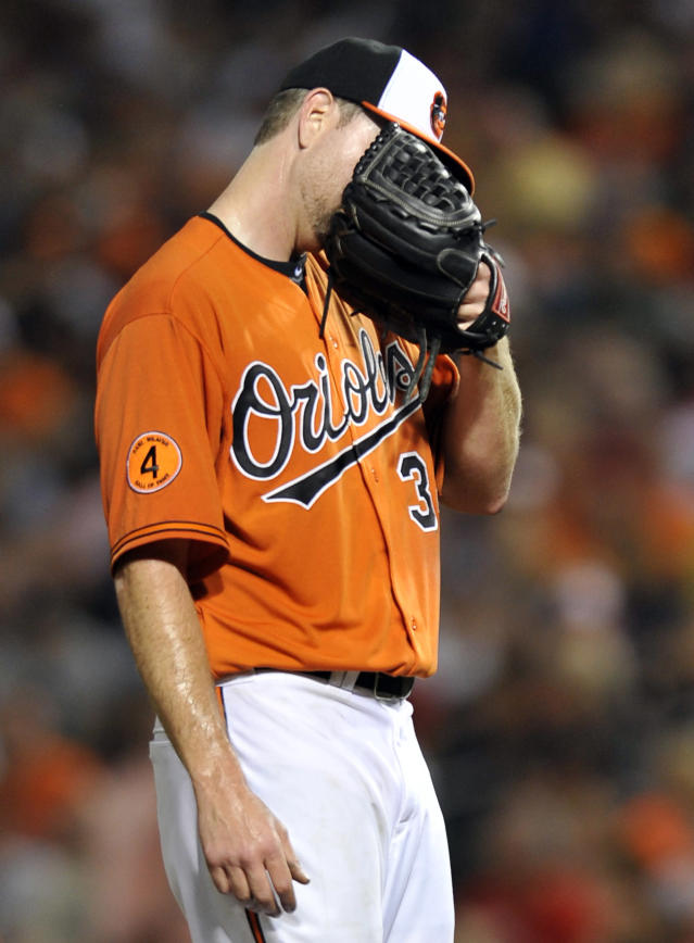 Baltimore Orioles starting pitcher Scott Feldman reacts after giving up a three-run home run to the Boston Red Sox in the fourth inning of a baseball game on Saturday, July 27, 2013, in Baltimore. (AP Photo/Gail Burton)