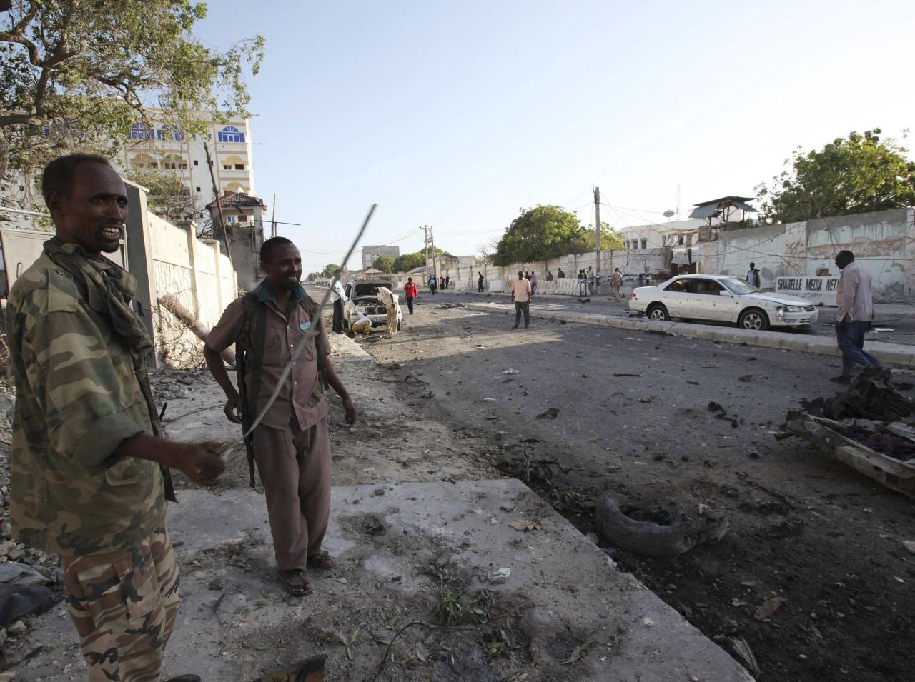 Soldiers assess the aftermath at the scene of an explosion outside Jazira hotel in Mogadishu, January 2, 2014. Three bombs exploded within an hour outside the hotel in a heavily fortified district of the Somali capital on Wednesday, killing at least 11 people. REUTERS/Omar Faruk (SOMALIA - Tags: CIVIL UNREST DISASTER MILITARY)