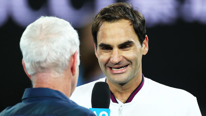Roger Federer is interviewed by John McEnroe after winning his Men's Singles fourth round match against Marton Fucsovics of Hungary on day seven of the 2020 Australian Open at Melbourne Park on January 26, 2020 in Melbourne, Australia. (Photo by Cameron Spencer/Getty Images)
