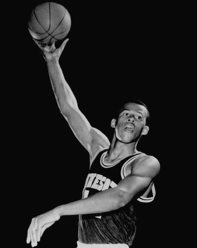 FILE - This is a May 12, 1966 file photo showing University of Minnesota basketball player Lou Hudson. Six-time All-Star Lou Hudson died Friday, April 11, 2014, in Atlanta, the Atlanta Hawks said. He was 69. His No. 23 was retired by the Hawks. Bob Pettit and Dominique Wilkins are the only other Hawks players to have their numbers retired. The University of Minnesota also retired Hudson's number. (AP Photo/File)