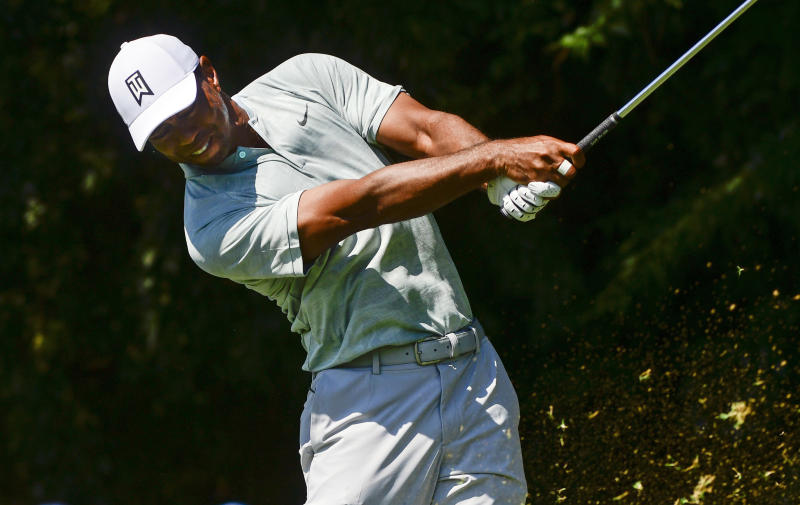 Woods, Rose tied for halfway lead at Tour Championship