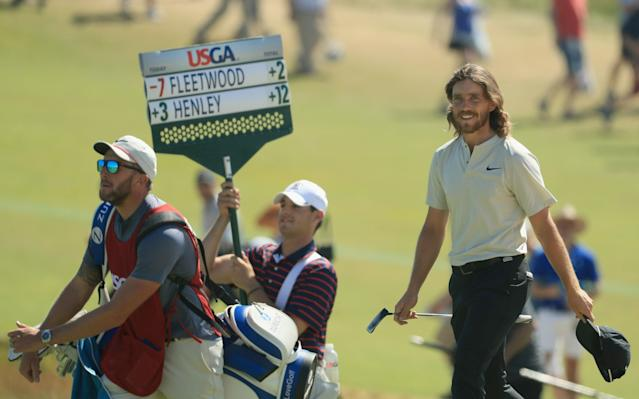 """<div class=""""caption""""> Tommy Fleetwood walks off the 18th green during the final round of the 2018 U.S. Open. </div> <cite class=""""credit"""">Mike Ehrmann/Getty Images</cite>"""